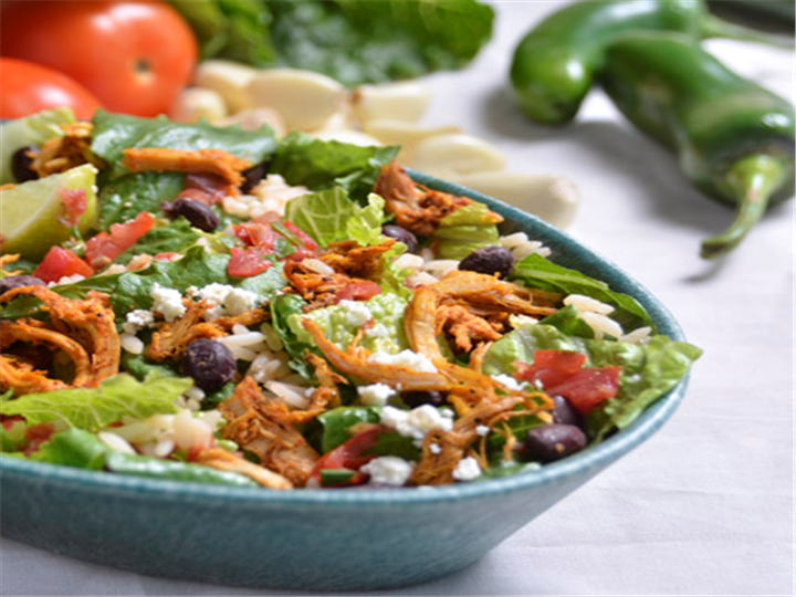 Carnitas salad with beans and rice.