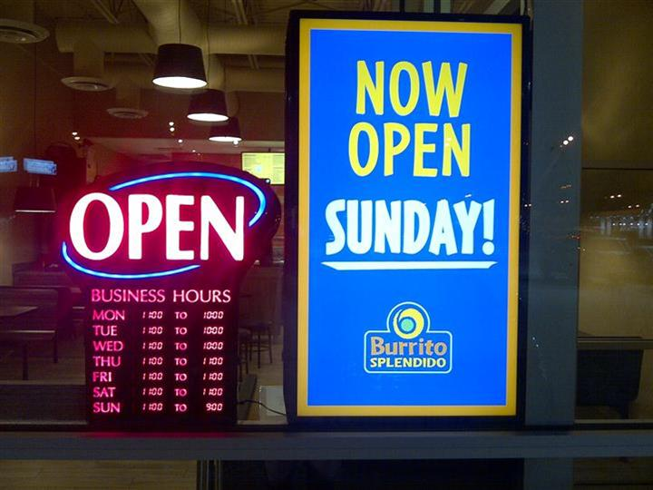 Signs in window - Open. Now open sunday.