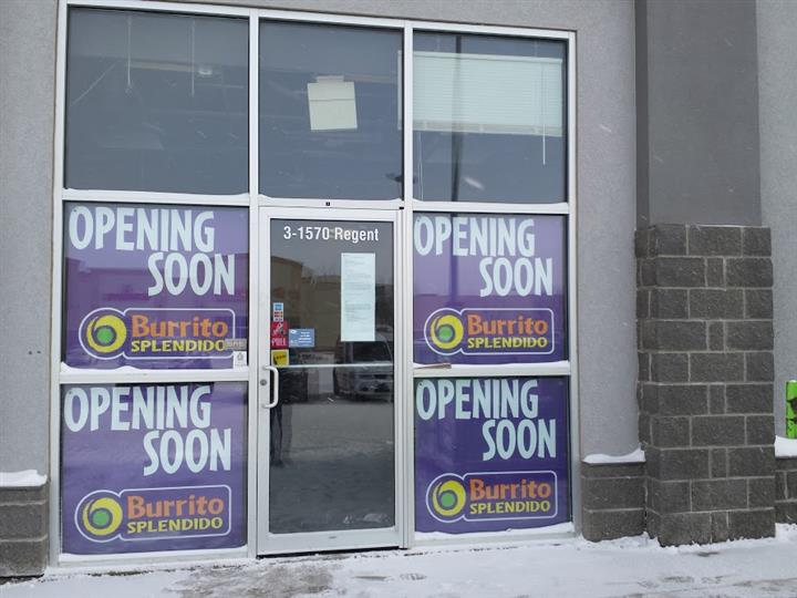 Signs in window at 3-1570 Regent that say Opening Soon burrito splendido.