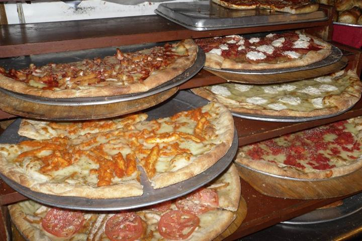 Pizzas on rack