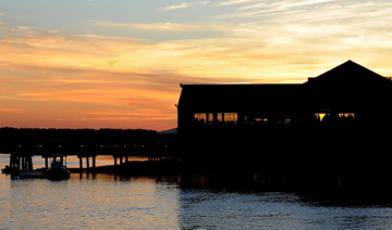 old oyster factory building view from the lake at sunset