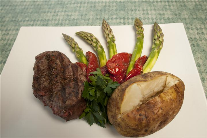 grilled steak with baked potato and vegetables