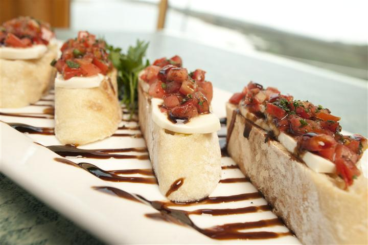 various slices of bread with salsa on top and herbs