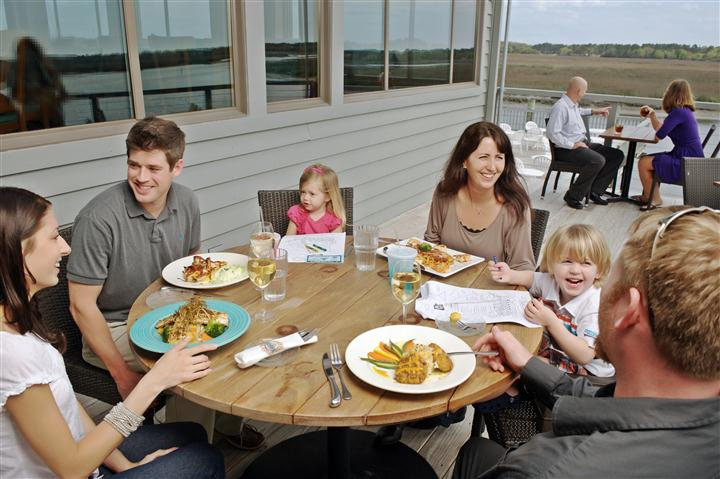 family enjoying a meal on the outdoor patio