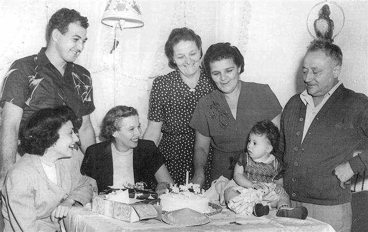 old black and white photo of a young child's birthday party