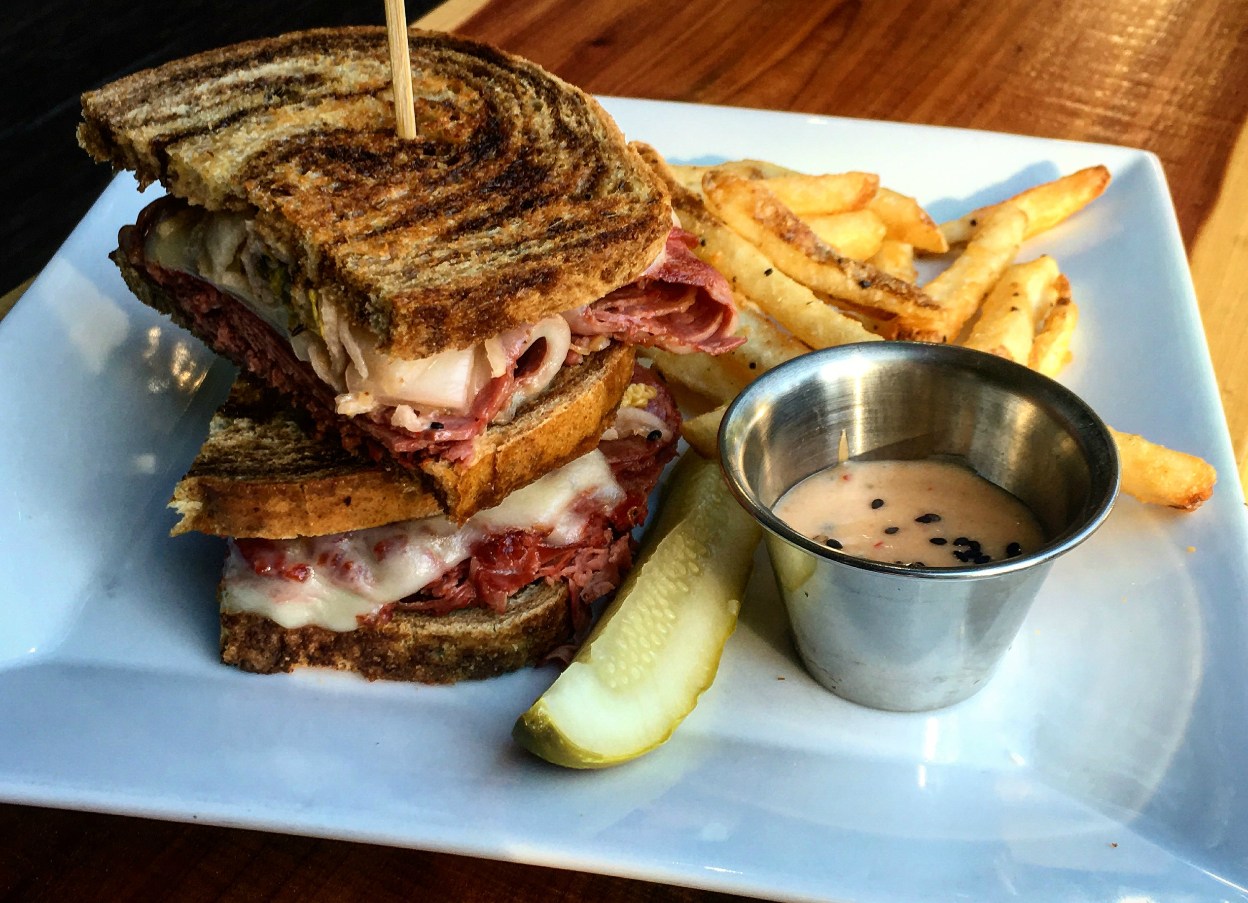 reubenesque. shaved corned beef, swiss cheese, kimchi, sweet chili mayo,  grilled rye