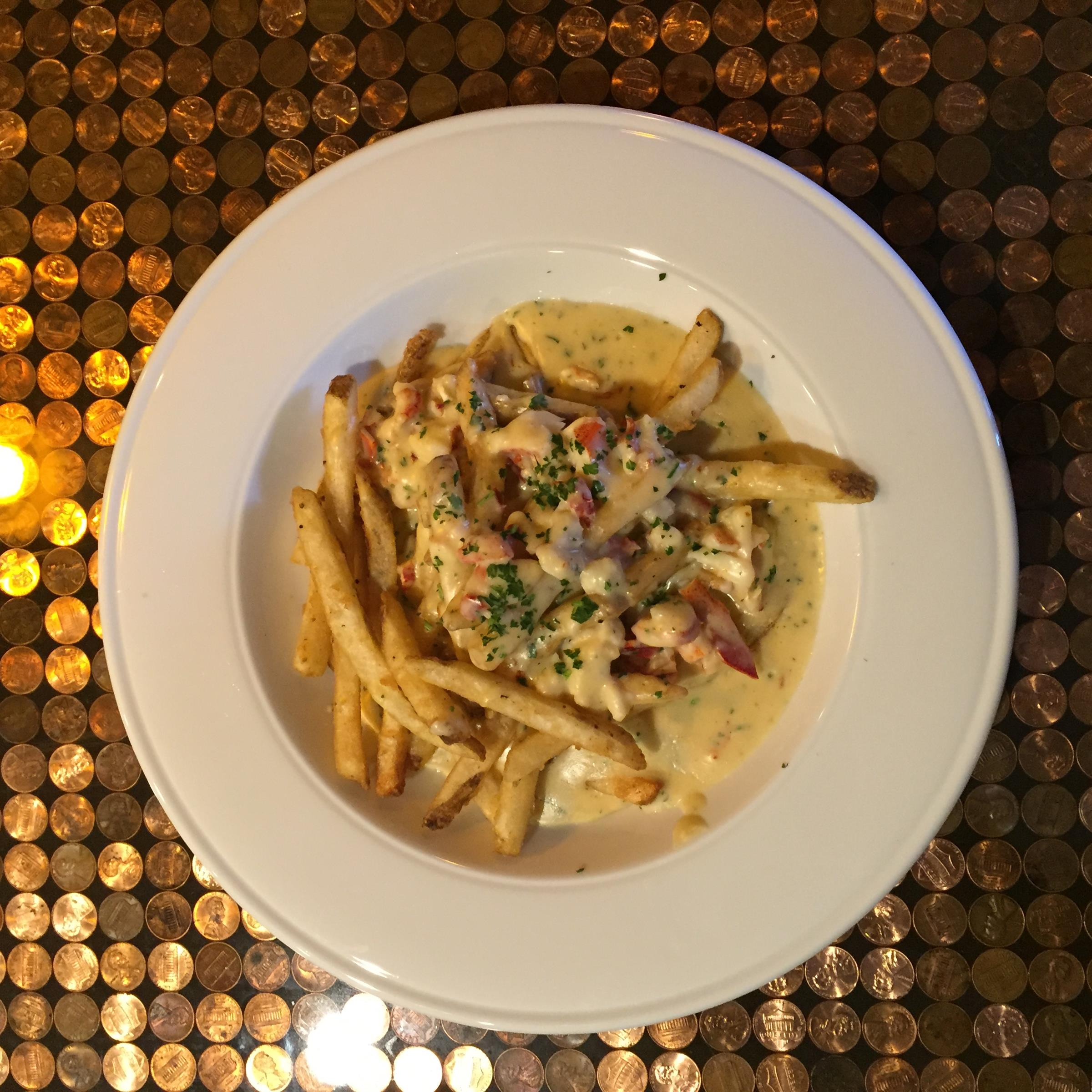 Lobsta fries. Maine lobster in a chipotle cream sauce, served on a bed of our crispy french fries.
