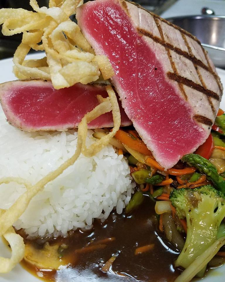 Seared ahi tuna with sticky rice, stir fried vegetables in soy chili ginger sauce.