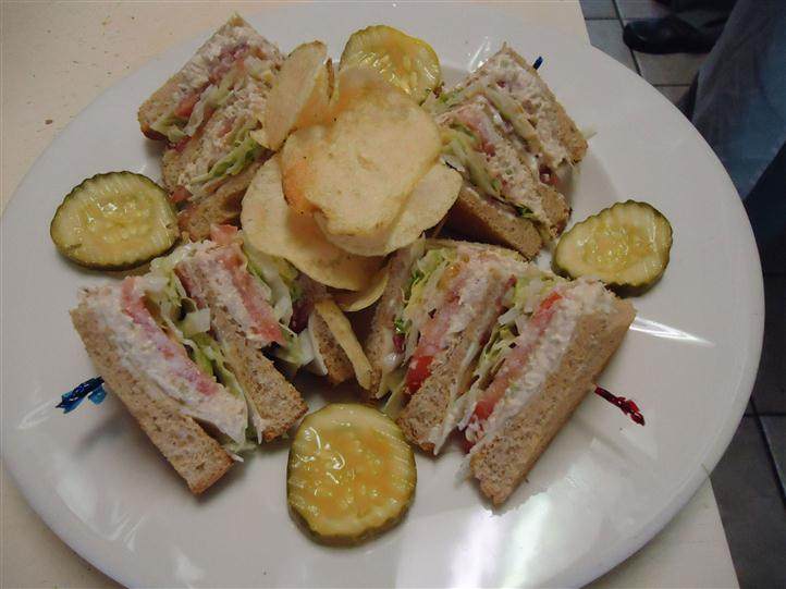 Sandwich with potato chips and pickle slices