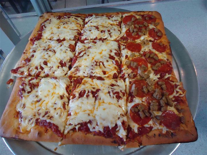 Grandma Pizza Pie with pepperoni and sausage chunks