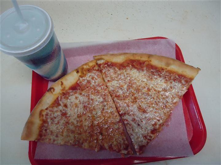 2 slices of pizza on a dining tray