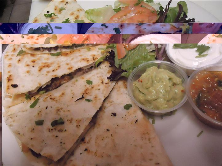 Quesadilla with tomato and guacamole dipping sauce