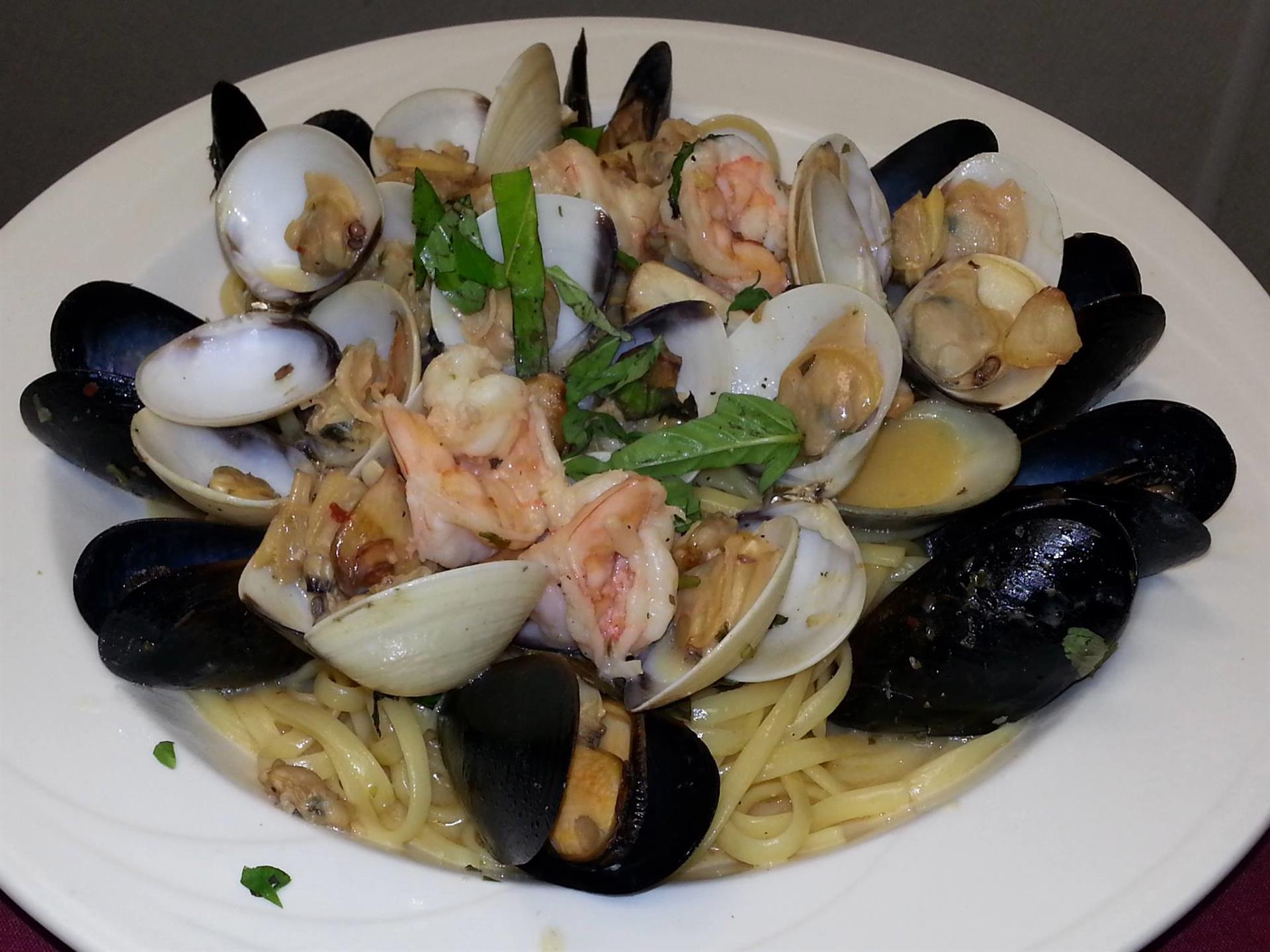 seafood entree with mussels, clams and shrimp