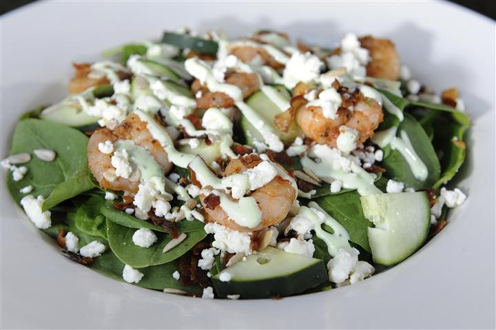 Salad with shrimp, cucumbers, ranch sauce and feta cheese