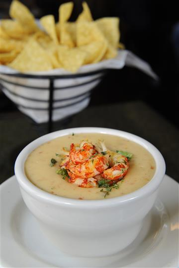 lobster bisque topped with scallions and fresh lobster chunks served with homemade pita chips