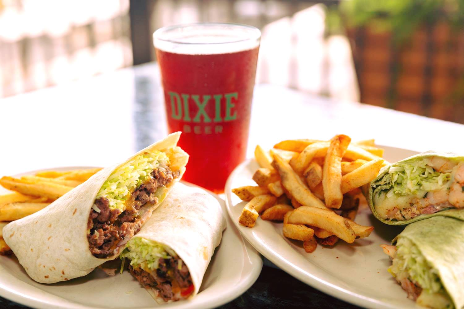 Two wrap dishes served with French fries.