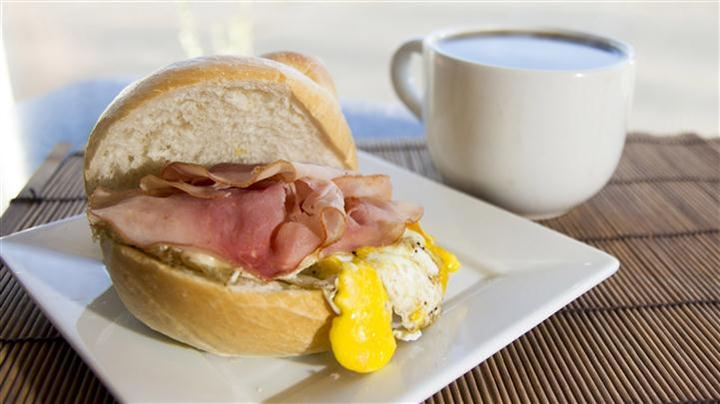 Egg sandwich with ham egg and cheese with side of coffee