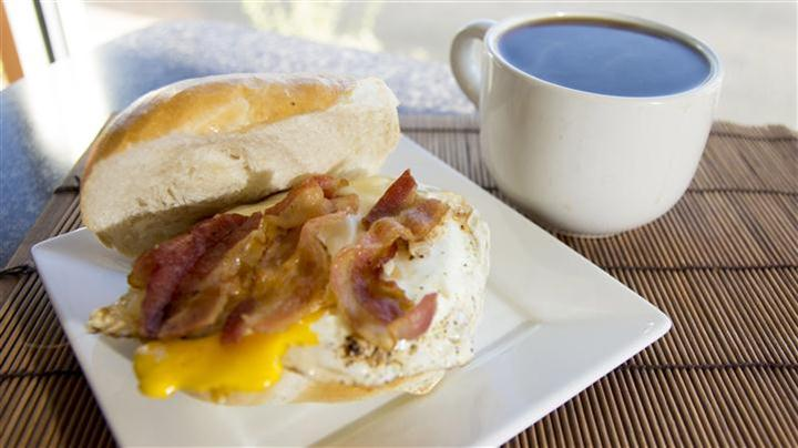 Egg sandwich with bacon egg and cheese with side of coffee