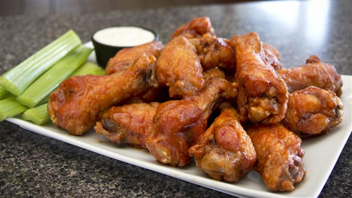 Crispy buffalo wings with celary and bleu cheese