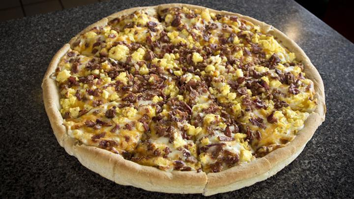 Pizza with ground beef and cheese