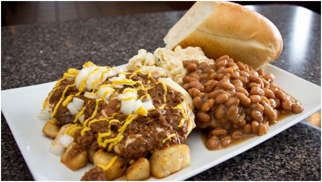 Sloppy joe meat over potatoes with beans and bread