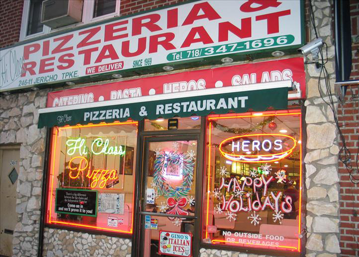 Hi-Class store front. Stone building with sign saying Pizzeria & Restaurant