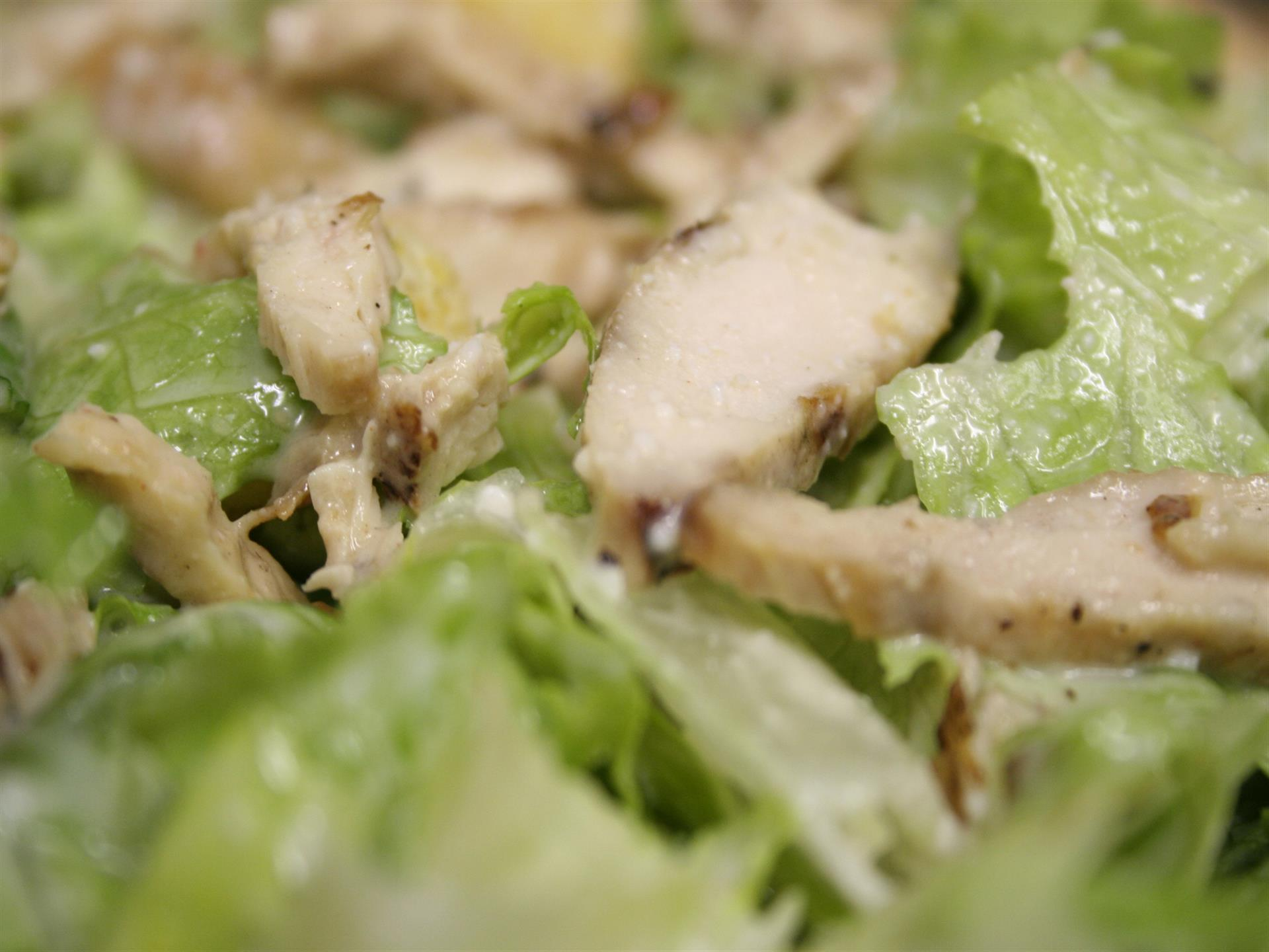 Cesar salad with grilled sliced chicken