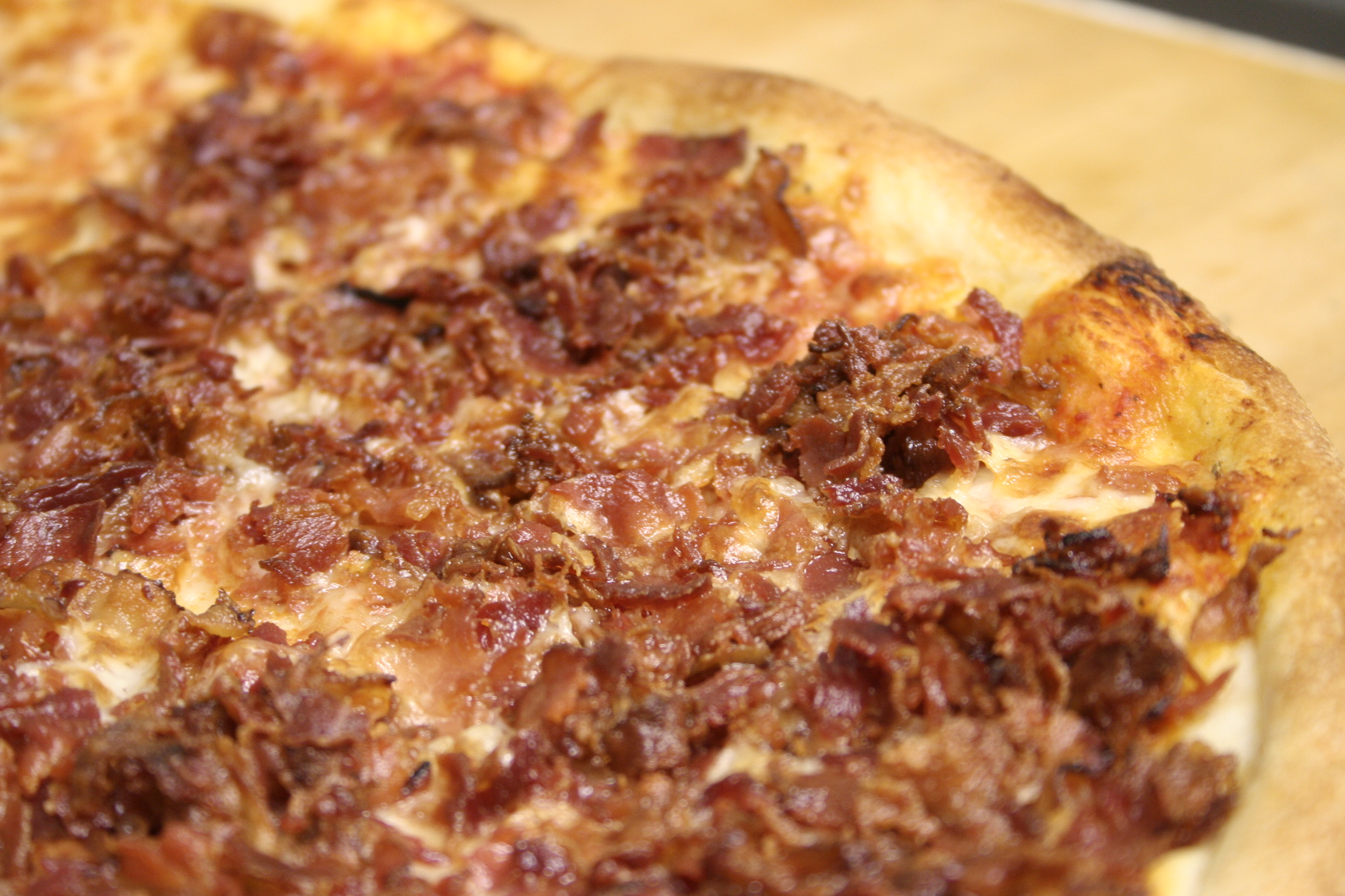 Pizza topped with cheese and bacon