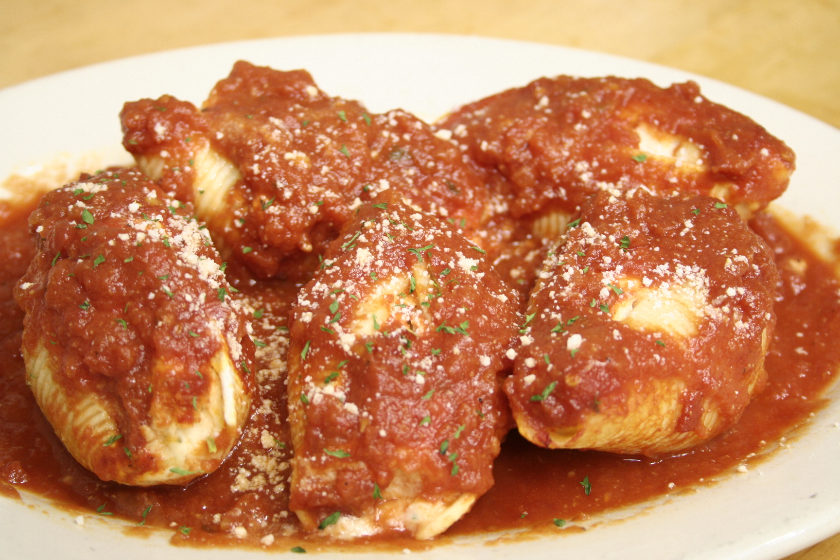 Stuffed shells topped with red sauce