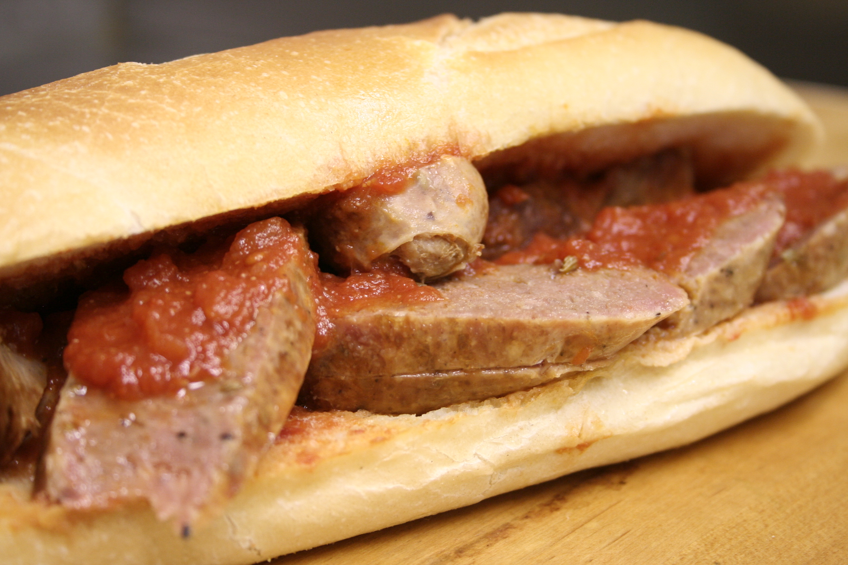 Sandwich with sausage and red sauce
