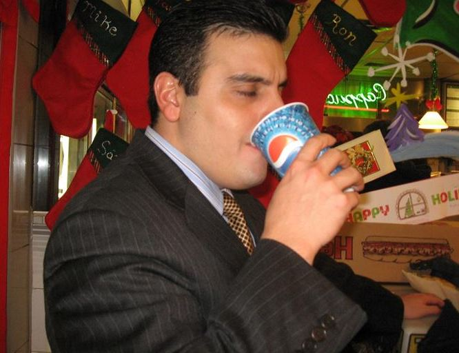 Man drinking soda out of a Pepsi cup