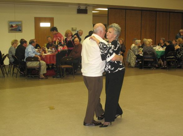 Two people dancing on dancefloor