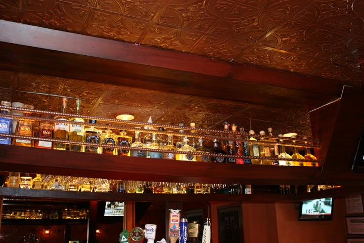 bottles of liquor lined up above the bar