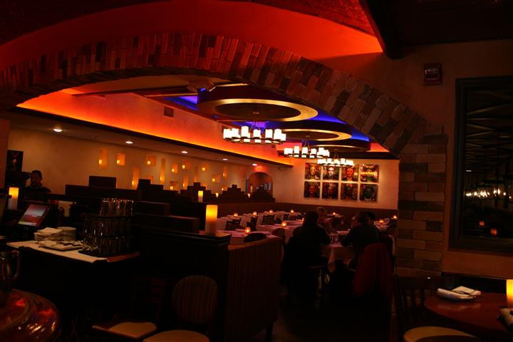 inside view of caracara mexican grill, with multiple tablecloth tables