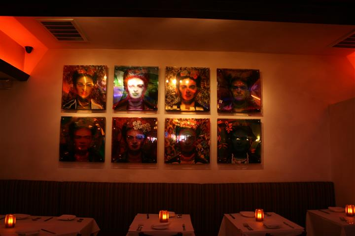 8 photos on the wall above tables