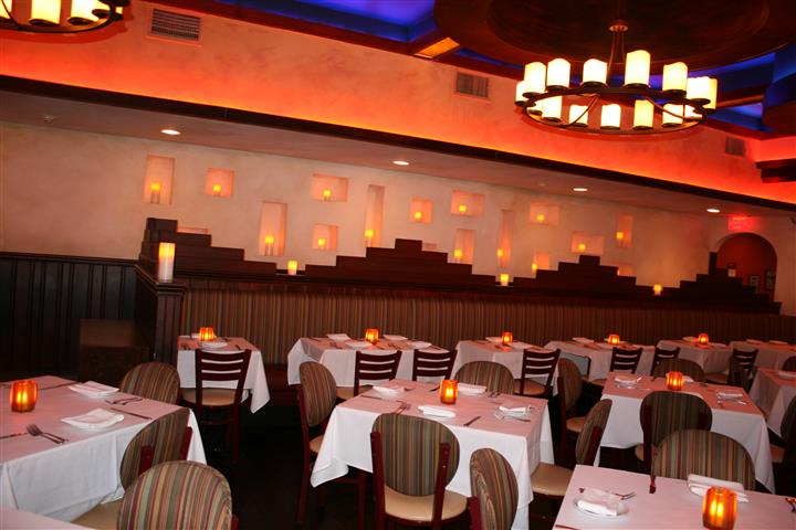 multiple tablecloth tables in Caracara Mexican Grill with candles as centerpieces