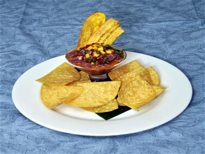 salsa with plantains dipped on, with chips on the side