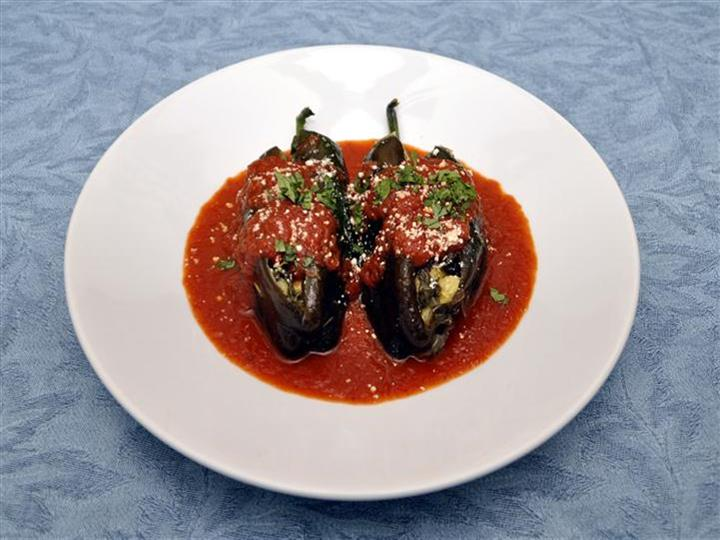 stuffed plantains with red sauce