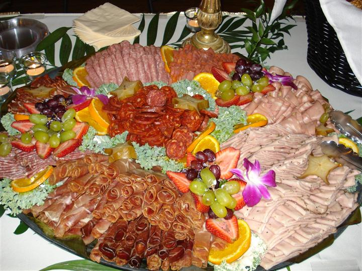 various meat and fruit on a tray