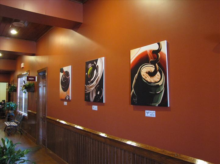 paintings hanging on the wall