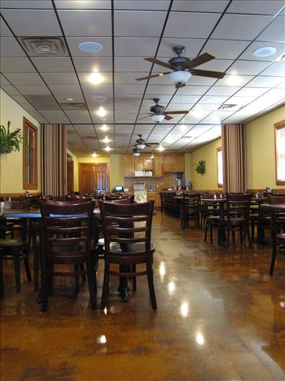 Inside view of restaurant with tables set