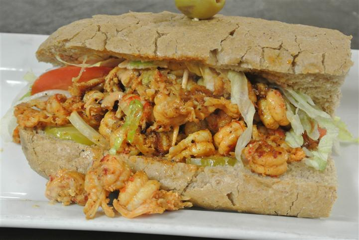 cooked seasoned shrimp in a sandwich with lettuce