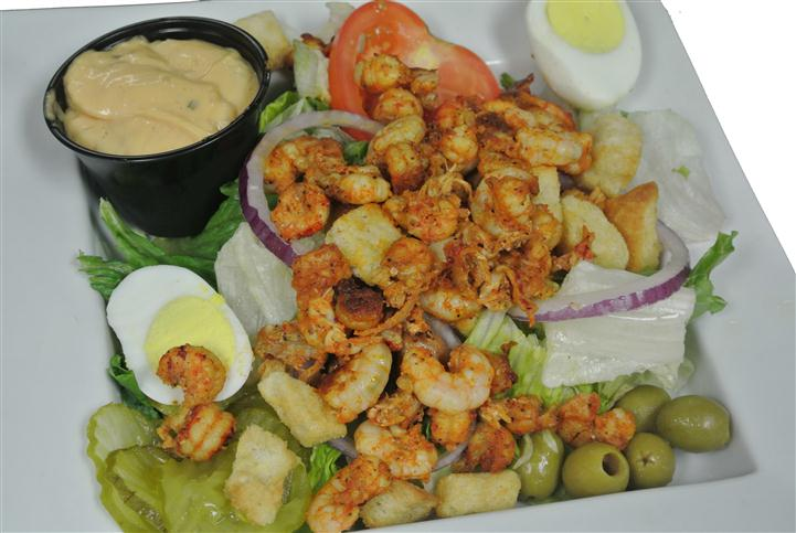 seasoned cooked shrimp on a bed of lettuce