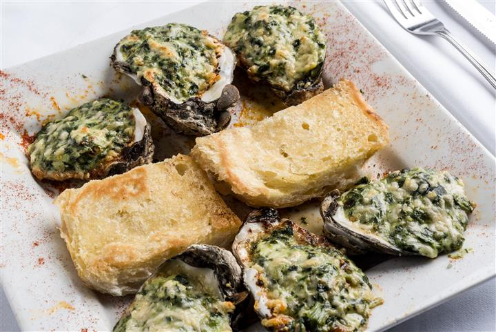 Charbroiled oysters with Fezzo's homemade butter sauce and creamy spinach and artichokes.