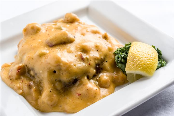 meat covered in a cream sauce