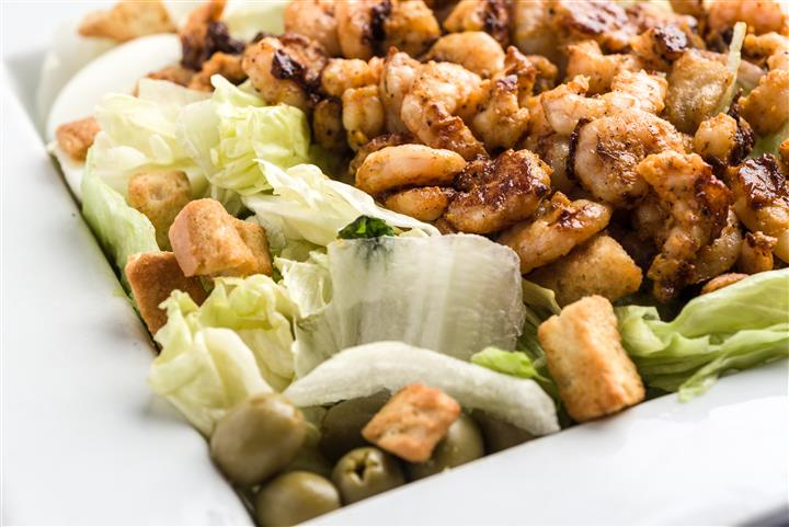 lettuce, olives, croutons, chicken pieces