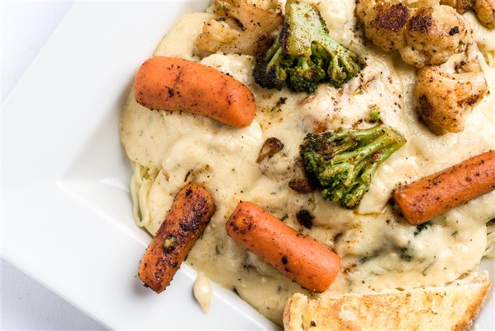 variety of roasted vegetables in a cream sauce