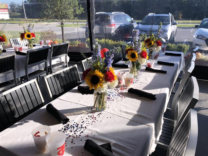 rectangular tables set with sunflowers