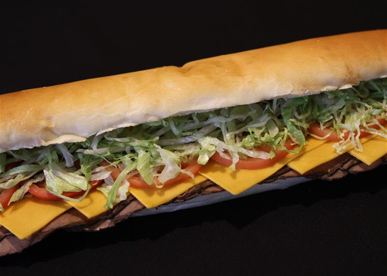 long sub sandwich with lunch meat, cheese, tomato and lettuce
