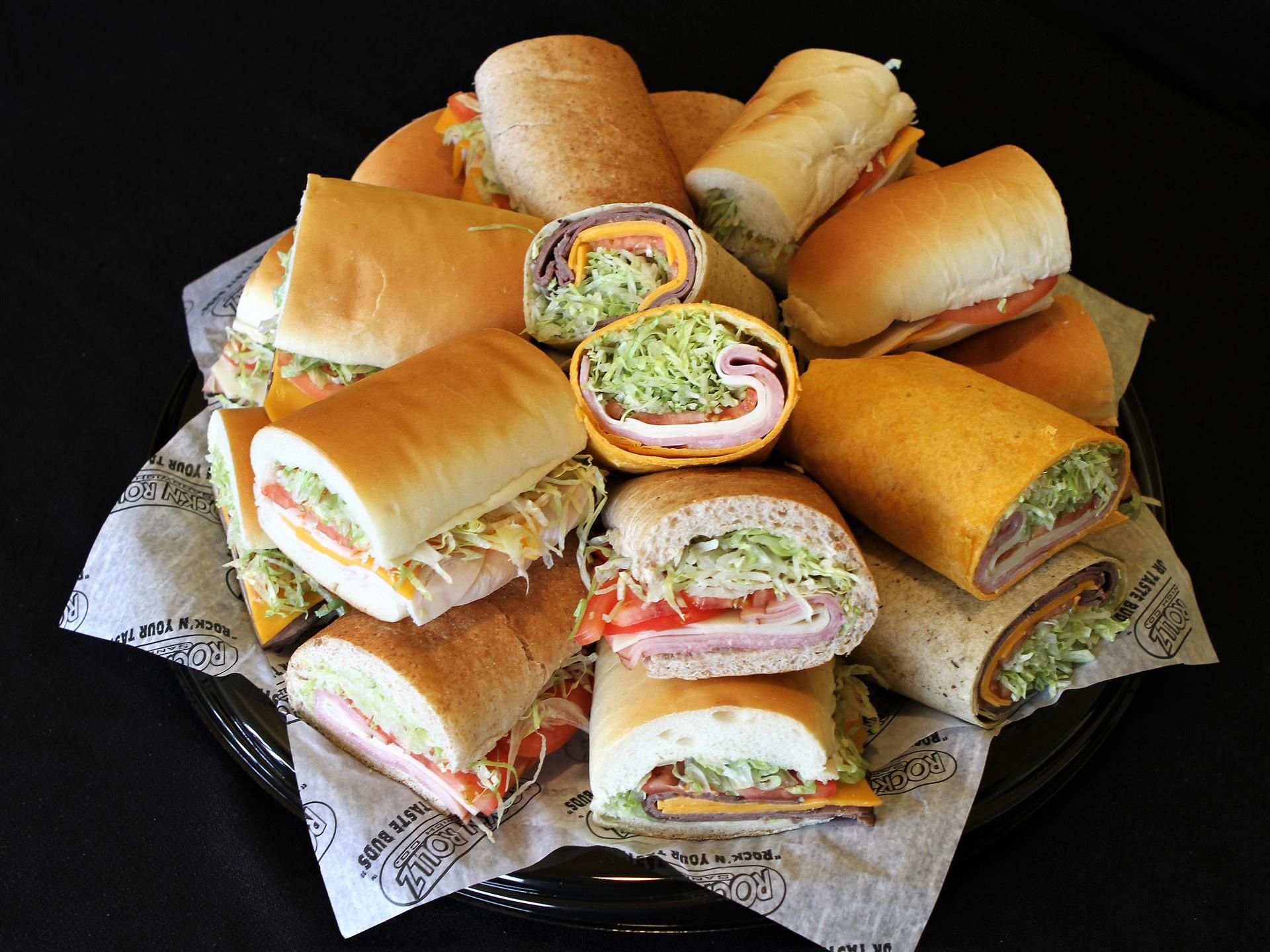 platter of assorted sandwiches and wraps